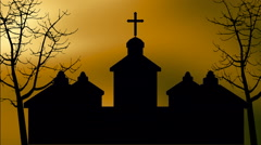 Silhouette of church and bare trees Stock Footage