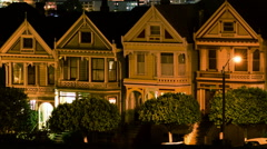 Time Lapse of Victorian Houses & Skyline in San Francisco at Night -Long Shot- - stock footage