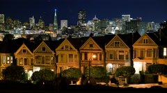 4K Time Lapse of Victorian Houses & Skyline in San Francisco at Night -Tilt Up- - stock footage
