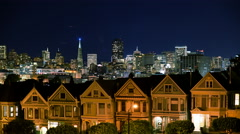 4K Time Lapse of Victorian Houses & Skyline in San Francisco at Night -Tilt Down - stock footage