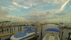 Time lapse video of boats docked at the Dinner Key Marina in Coconut Grove FL Stock Footage