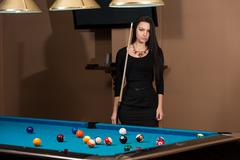 Stock Photo of portrait of a young woman concentration on ball