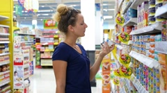 Young Woman Choosing Food in the Supermarket. Grocery. Arkistovideo