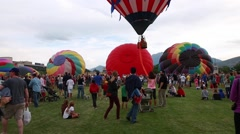 People walking around hot air balloon festival Stock Footage