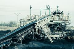 Opencast brown coal mine. belt conveyor. Stock Photos