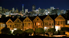 4K Time Lapse of Victorian Houses & Skyline in San Francisco at Night -Zoom In- - stock footage