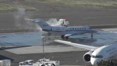 Spraying deicer on a jet Stock Footage