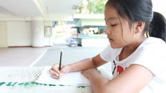 Asian lady to drawing cartoon - stock footage