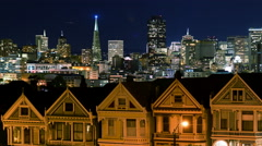 4K Time Lapse of Victorian Houses & Skyline in San Francisco at Night -Zoom Out- - stock footage
