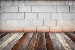 room interior vintage with grey brick wall and wood floor background - stock photo