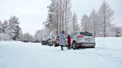Mother and child get in the car after tubing at winter season. Ski resort Stock Footage