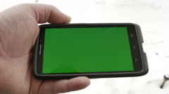 2848 Man Using Smart Phone with Green Screen in Snow, 4K Stock Footage