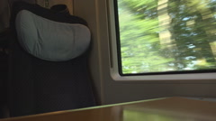 Interior modern passenger train comfortable chair window view landscape journey Stock Footage