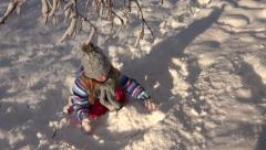 4K Little Girl Playing in Snow in Winter, Child Making Snowball, Snowman in Park Stock Footage