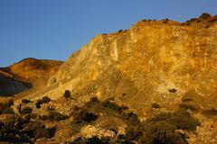 Morning rocky cliff Stock Photos