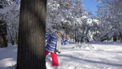 4K Child Hiding Tree Trunk in Park, Forest, Happy Little Girl Play Hide and Seek Stock Footage