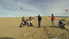 Little Sahara sand dunes motorcycle ride family friends HD 338 Stock Footage