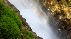 Closeup of Rio Del Verde waterfall in Abruzzi, Italy, with sunbeam. Stock Footage