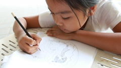 Asian lady to drawing cartoon Stock Footage