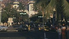 Acapulco 1975: traffic in front of Nuestra Señora de la Soledad Stock Footage