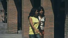 Acapulco 1975: young girls walking in the street Stock Footage
