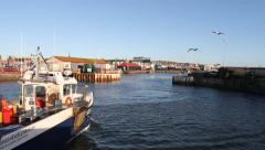 Fishing boats arriving Arbroath harbour Scotland Stock Footage