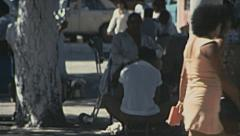 Acapulco 1975: shoeshiner working in the street Stock Footage
