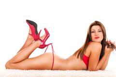 Naked brunette in red high heel Kuvituskuvat
