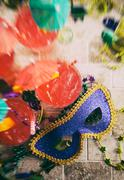 Stock Photo of mardi gras: focus on party mask with drinks and beads around