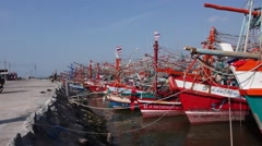 Colored red and blue Thai boats fishing boats dock, Old wooden boat, Thai ship. - stock footage