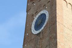 bell tower with  large clock with roman numerals - stock photo