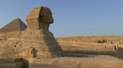 Famous ancient Sphinx and Cheops pyramid in Giza Cairo Egypt - pan Stock Footage