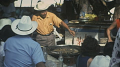 Acapulco 1975: man cooking fish outdoor - stock footage