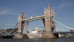Timelapse of a cruise ship passing through Tower Bridge, London. Not graded - stock footage