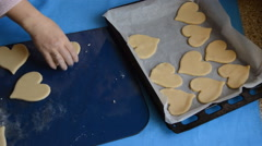 Woman Puts Heart Shaped Dough On A Baking Sheet Stock Footage