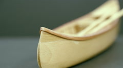 A small wooden canoe boat on the table Stock Footage