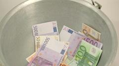 lots of euro bills inside a metal pail - stock footage