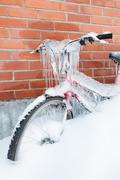 Frozen bike covered in ice - stock photo