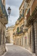 Stock Photo of street with old houses in the historical center of lecce
