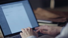 Typing a Mail Message on Notebook at Home. Causal Lifestyle Stock Footage