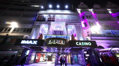Empire cinema and casino at London Leicester Square by night - stock footage