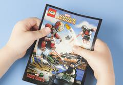 Comic book lego super heroes in child's hands Kuvituskuvat