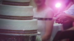 Bride and Groom Cutting cake slow motion Stock Footage
