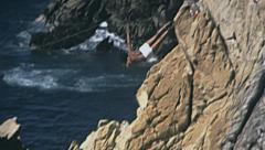 Acapulco 1975: man diving in slow motion at La Quebrada Stock Footage