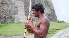 Brazilian playing Berimbau Instrument in Salvador, Bahia, Brazil. Stock Footage