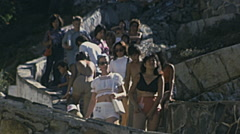 Acapulco 1975: spectators on the way to La Quebrada peak - stock footage