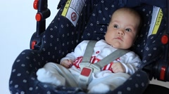 Baby on Child Safety Seat Stock Footage