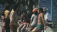 Acapulco 1975: people talking in front of the Ocean Stock Footage