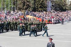 russian soldiers march at the parade on annual victory day - stock photo
