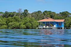 Overwater bungalow viewed from sea surface panama Stock Photos